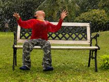 Kid in a park playing in the rain. Kid playing in the rain Royalty Free Stock Photo