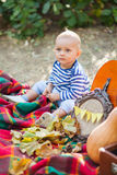 Kid in the park with a pumpkin Stock Photography