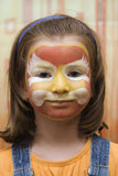 Kid with party- colored face Stock Image
