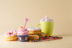 Kid Party decoration. Cupcake with donuts Royalty Free Stock Photography