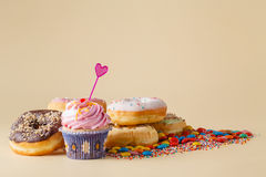 Kid Party decoration. Cupcake with donuts Stock Photography