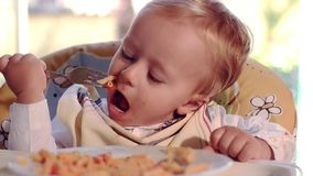 Kid and pasta stock footage