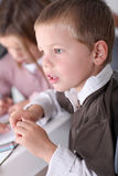 Kid paying attention in class Royalty Free Stock Photos