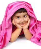Kid peeking out from blanket. Cute three year old Hispanic girl peeking out from under a hot-pink blanket, on white background stock images