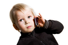 Kid on phone Stock Images