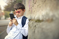 Kid with phone Stock Photo
