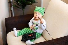 Kid and phone Stock Image