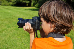 Kid with photocamera Stock Images