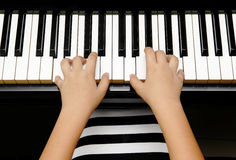 Kid with piano Stock Photography