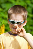 Kid picking his nose Stock Photo