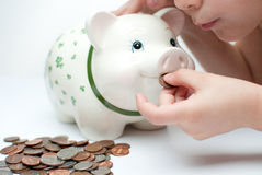 Kid with a piggy bank Royalty Free Stock Photography