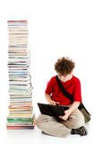 Kid and pile of books. Young boy sitting next to pile of books on white background Stock Photography