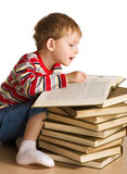 Kid with a pile of books Royalty Free Stock Photos