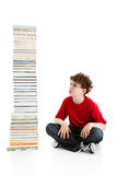 Kid and pile of books Royalty Free Stock Photos