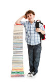 Kid and pile of books Royalty Free Stock Photo