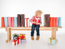 Kid with pile of gift boxes Stock Photo