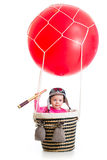 Kid with pilot hat and spyglass on hot air balloon Stock Photo