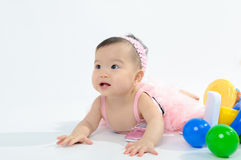 Kid in pink dress playing toy Stock Photo
