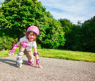 Kid in pink protective sportswear Royalty Free Stock Images