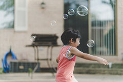 Kid in Pink Tanktop Playing Bubbles Stock Photography