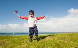 Kid with a Pinwheel. Royalty Free Stock Images