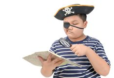 Kid pirate using magnifying glass to view the map. Fat pirate using magnifying glass to view the map isolated on white background, funny concept stock images