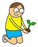 Kid planting a plant Royalty Free Stock Image