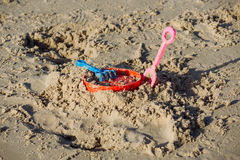Kid plastic sand toy. Color of Kid plastic sand toy on sand beach during day light Royalty Free Stock Image