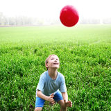 Kid play with a Ball Stock Photo