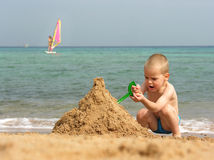 Kid play on beach Royalty Free Stock Images