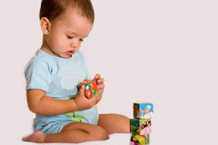 Kid play with bricks Royalty Free Stock Photos