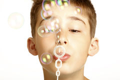 Kid play with bubbles. On white Royalty Free Stock Photos
