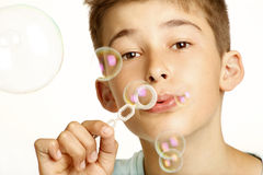 Kid play with bubbles Stock Photography