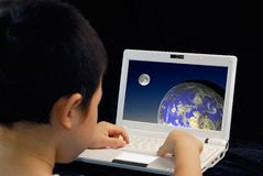 Kid play computer Royalty Free Stock Photos
