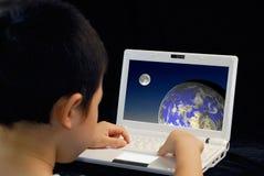 Kid play computer royalty free stock photos