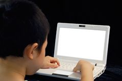 Kid play computer Royalty Free Stock Photography