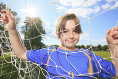 Kid play soccer on a field Stock Photo