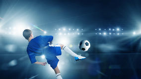 Kid play soccer on stadium Royalty Free Stock Photos