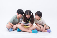 Kid play tablet. Smart phone playing young online social fun children girl boy stock photos