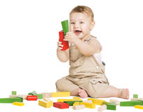 Kid Play Toys Blocks, Child Playing Toy on White. Kid Play Toys Blocks, Happy Child Playing Toy on White background Stock Image
