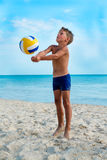 Kid play volleyball on a sea beach Royalty Free Stock Photography