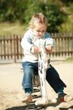 Kid at playground Stock Photo