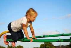 Kid on playground Stock Images