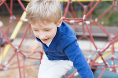 Kid at playground Royalty Free Stock Image