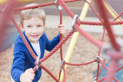 Kid at playground Stock Images