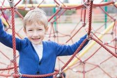 Kid at playground Royalty Free Stock Photo