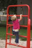 Kid playing. A kid playing on a climbing-rack royalty free stock image
