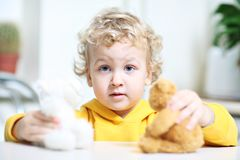 Kid is playing. Royalty Free Stock Photos