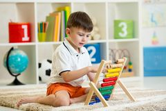 Kid playing with abacus Stock Photography