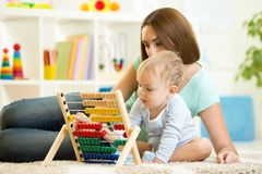 Kid playing with abacus Stock Photos